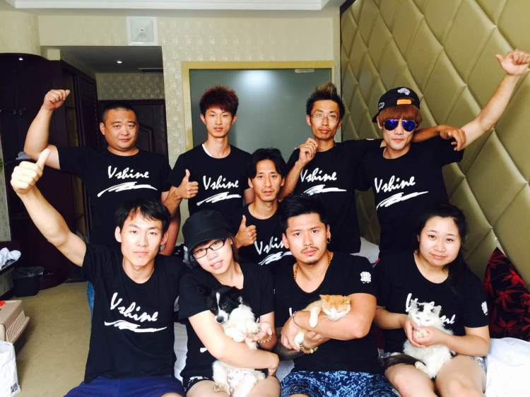 """Vshine activists with animals rescued by Peter Li, HSI China policy specialist. Vshine means """"a small light of kindness that brings great change."""""""